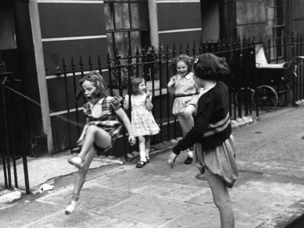 children-skipping-on-pavement