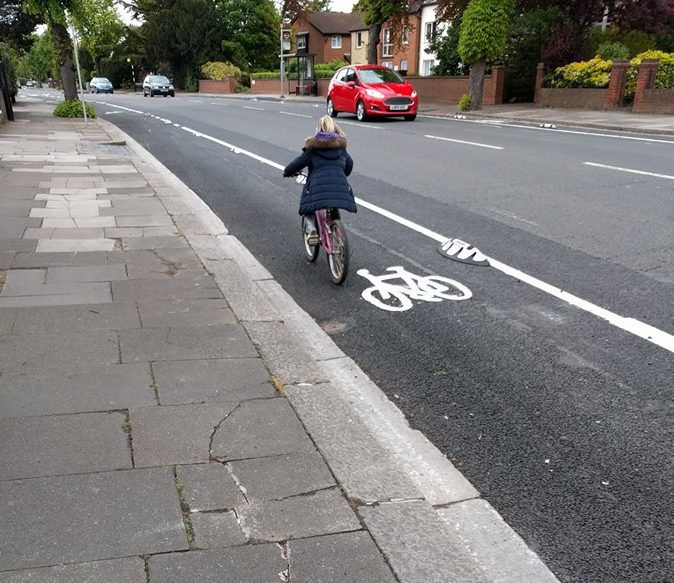 A 6-year-old tries out her bike on the A105, having just bought it from the Cycle Enfield bike market